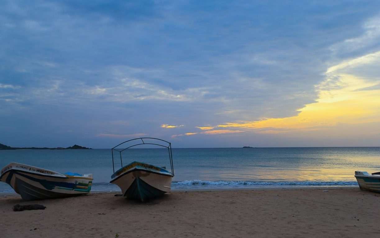 boats sunset beach Trincomalee sri lanka