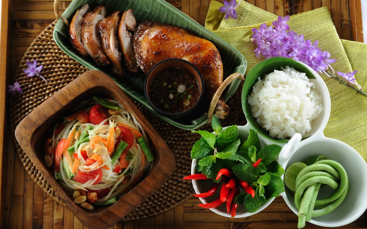 Thai Food Som Tam With Khao Niaw and Gai Yang