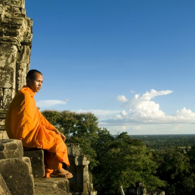 monk by temple siem reap cambodia