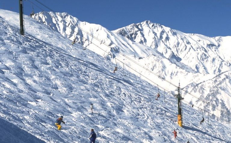 skiers snow mountain Hakuba Japan