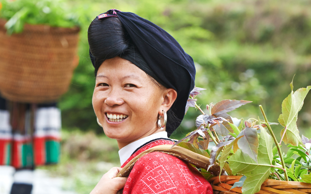 Chinese Tribe Lady carrying a basket